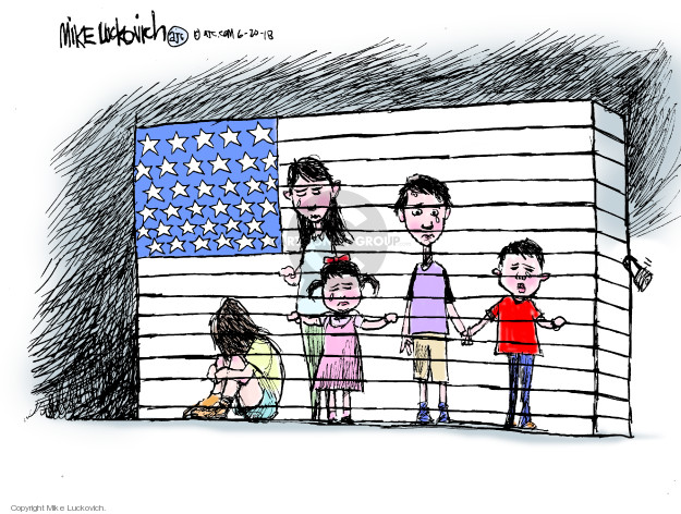 No caption (Separated immigrant children are locked inside a United States flag.