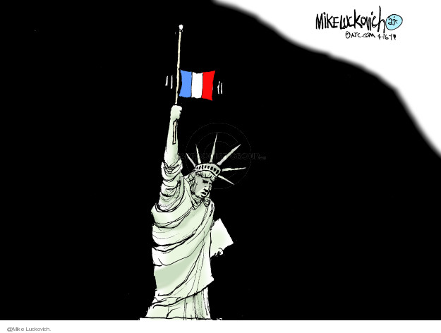 No caption (A grieving Statue of Liberty holds up a French flag flying at half-staff).